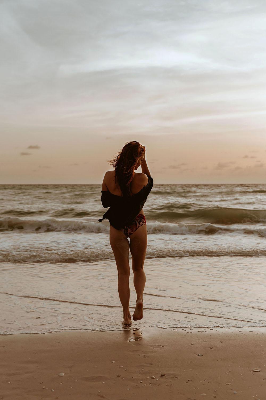 Naples Boudoir Photographer, woman walking toward the beach