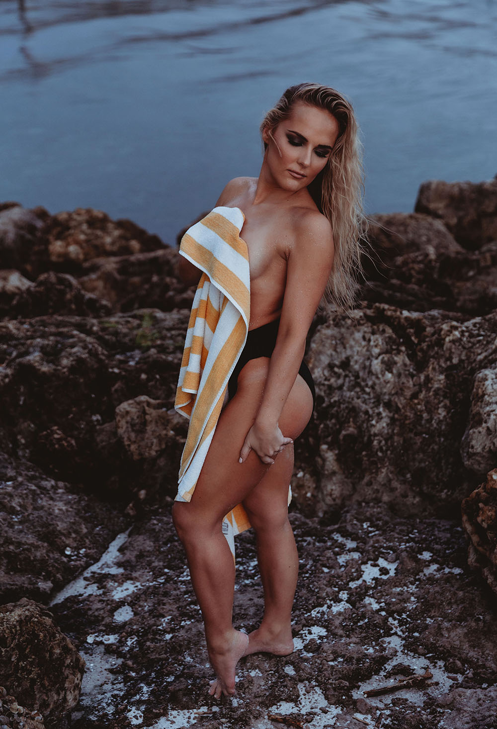 Naples Boudoir Photographer, woman wrapped in a towel at the beach