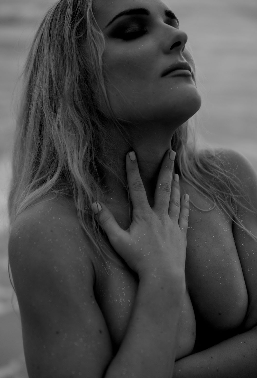 Naples Boudoir Photographer, topless woman covered with sand