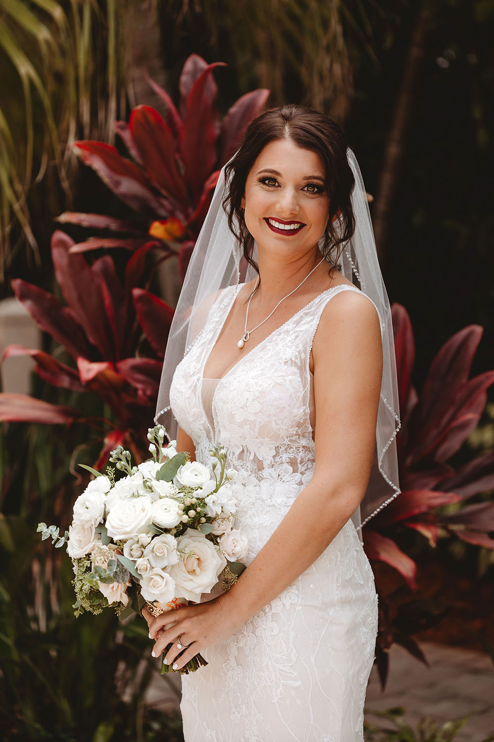 Naples Wedding Photographer, bride with white bouquet
