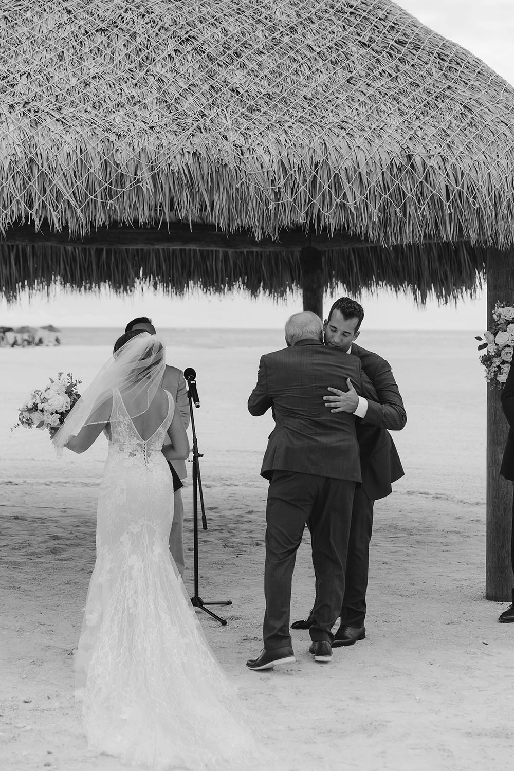 Naples Wedding Photographer, groom hugging father of the bride