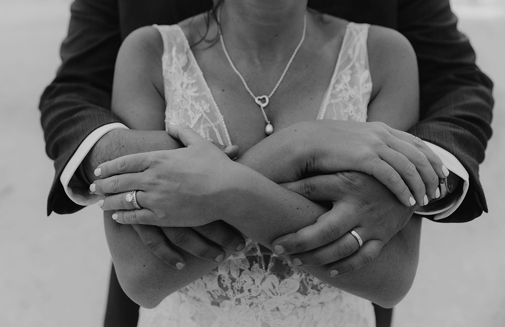 Naples Wedding Photographer, black and white of groom wrapping his hands around his bride