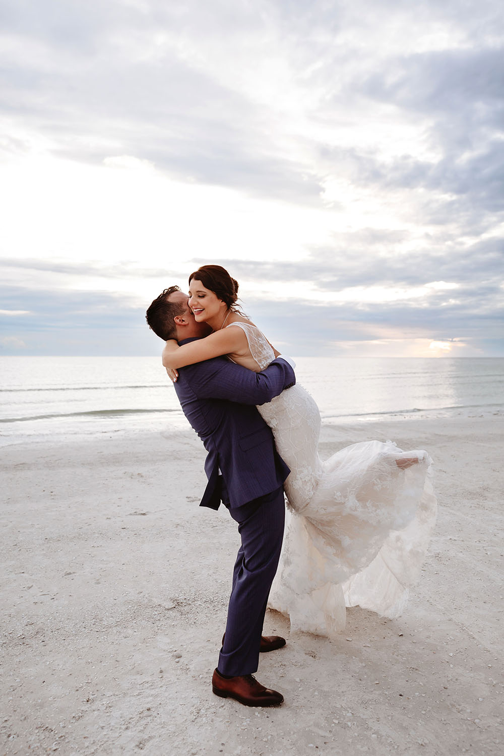 Naples Wedding Photographer, groom hugging and lifting up bride