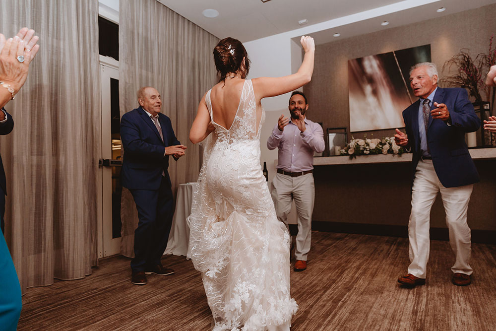 Naples Wedding Photographer, bride dancing at the reception