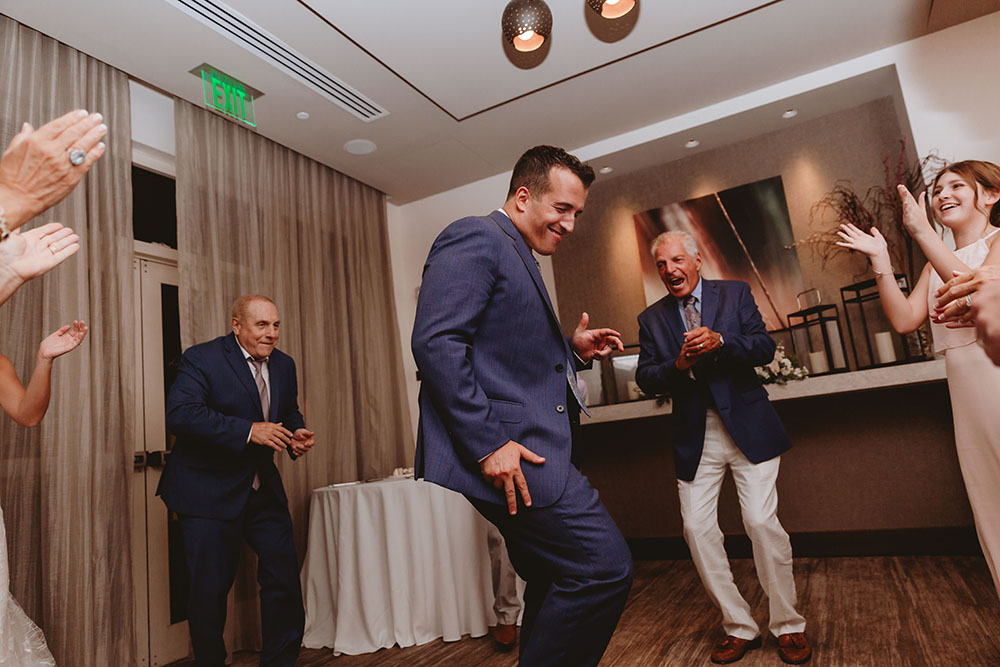 Naples Wedding Photographer, groom dancing at reception