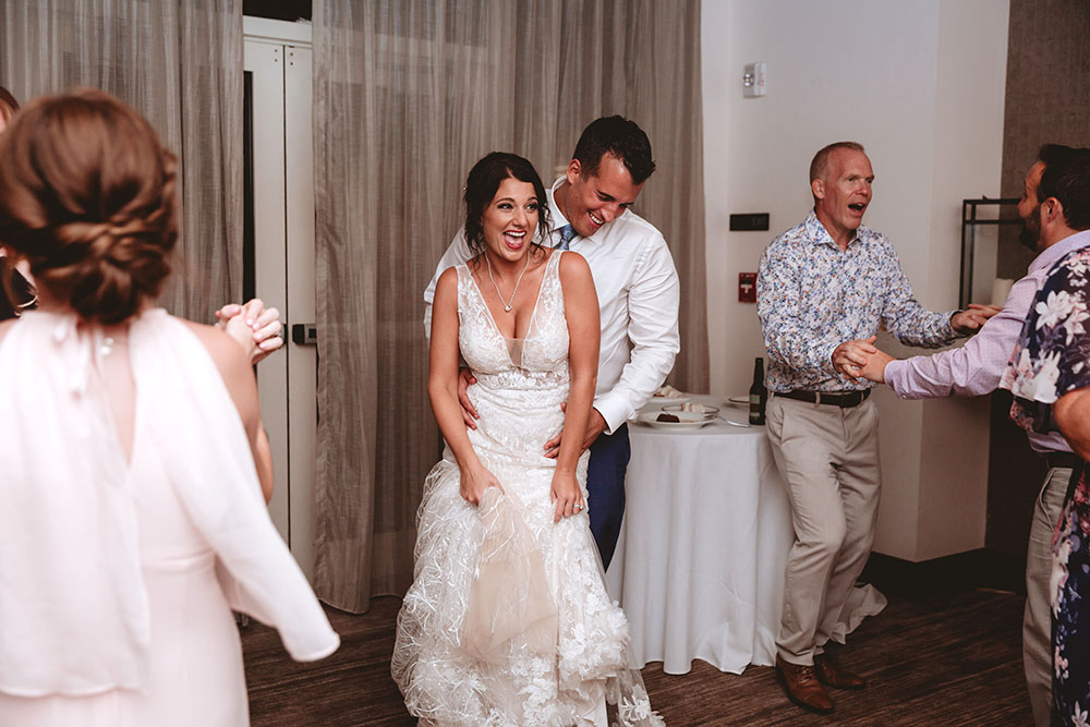 Naples Wedding Photographer, couple smiling and dancing