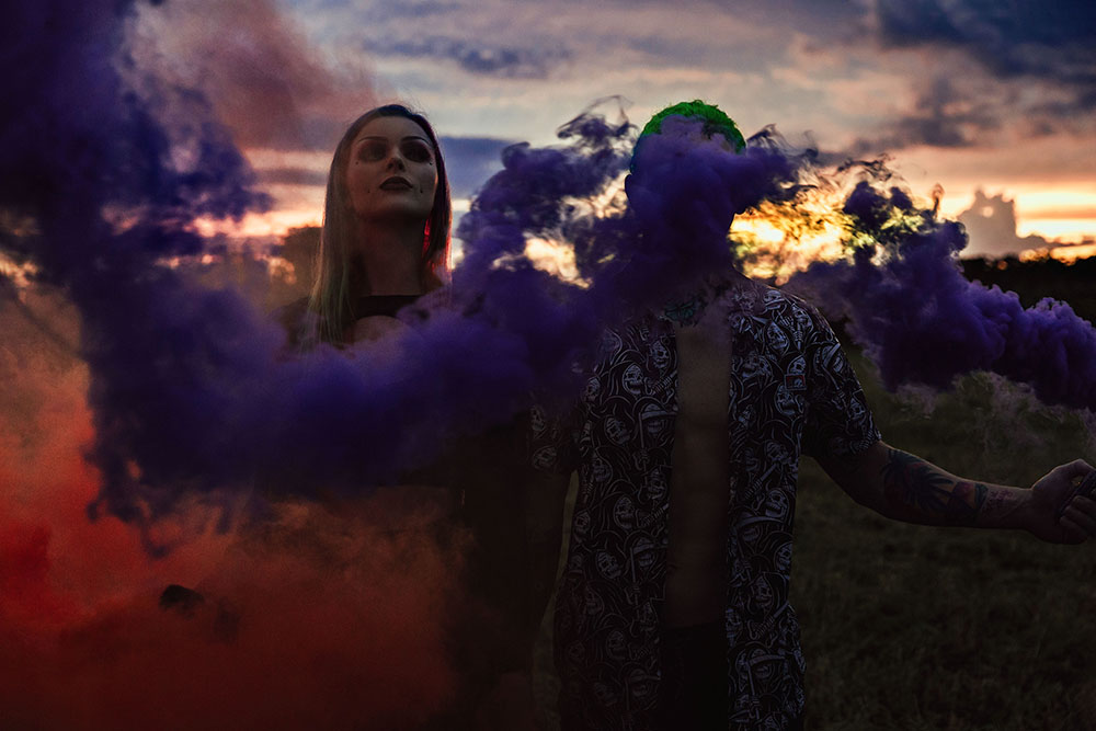 Naples Couples Photographer, couple playing with a colorful smoke bomb