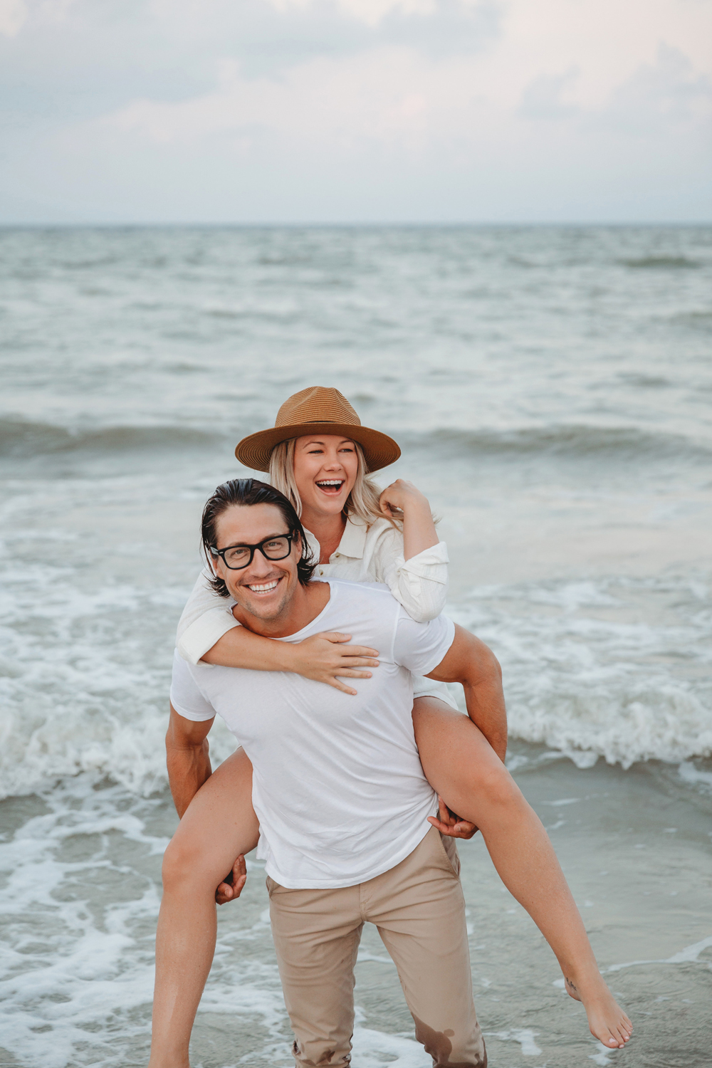 Naples Couples Photographer, piggyback in the water
