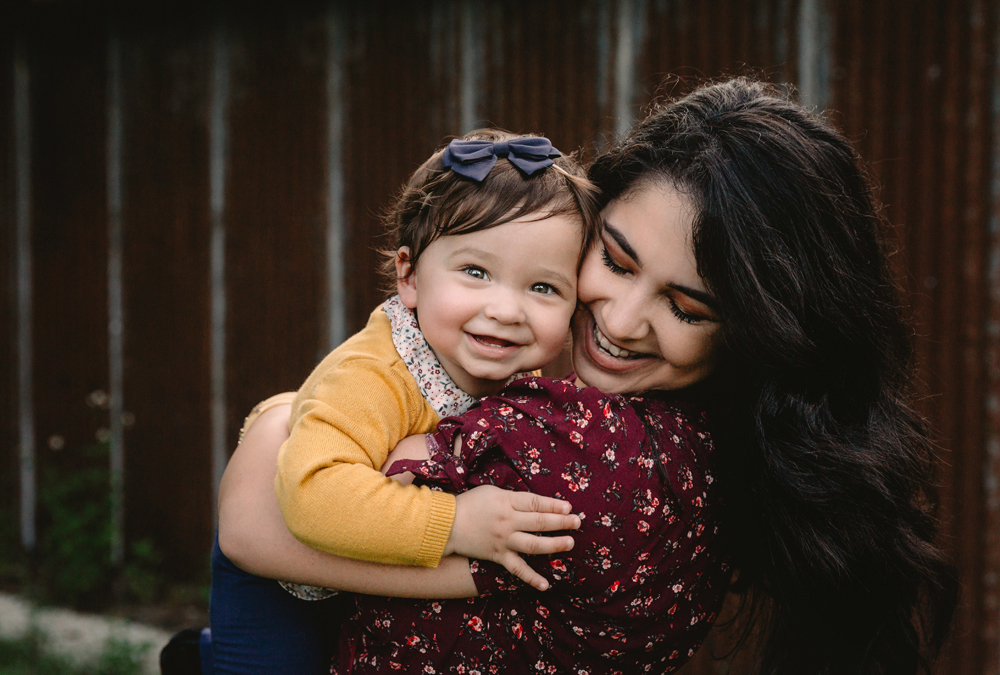 Naples Family Photographer, mother holding daughter