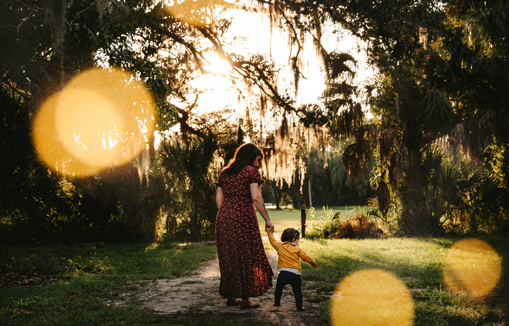 Naples Family Photographer, mother walking with little girl holding her hand