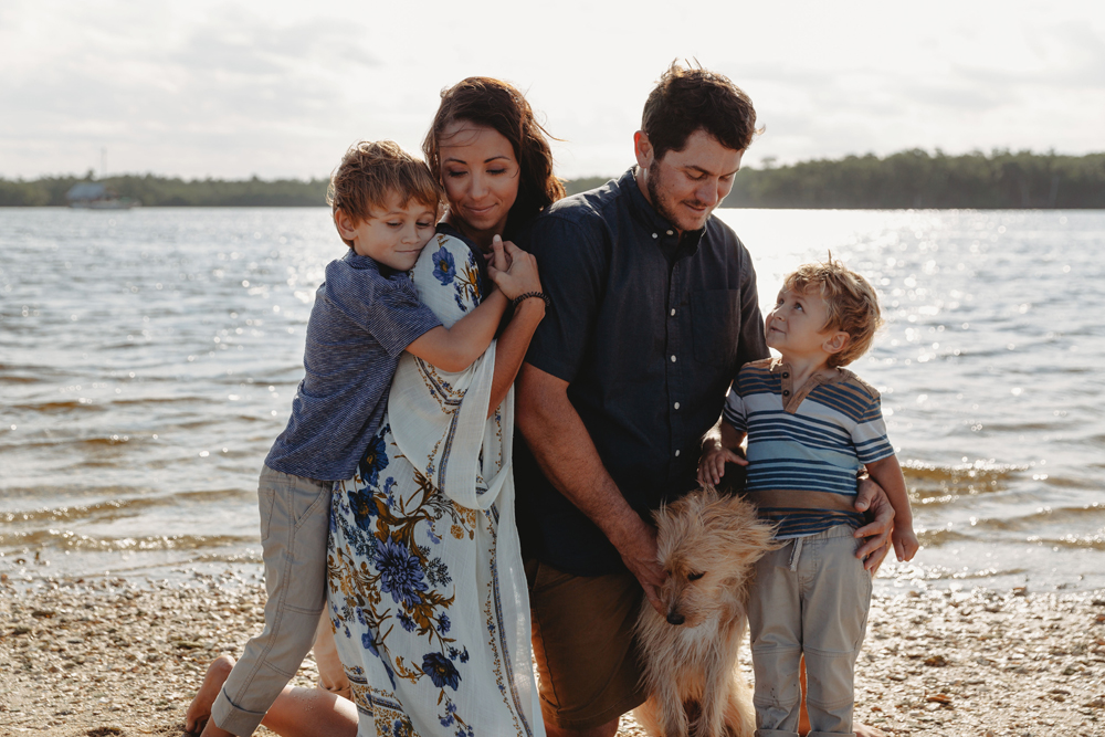 Naples Family Photographer, family playing by lake with dog