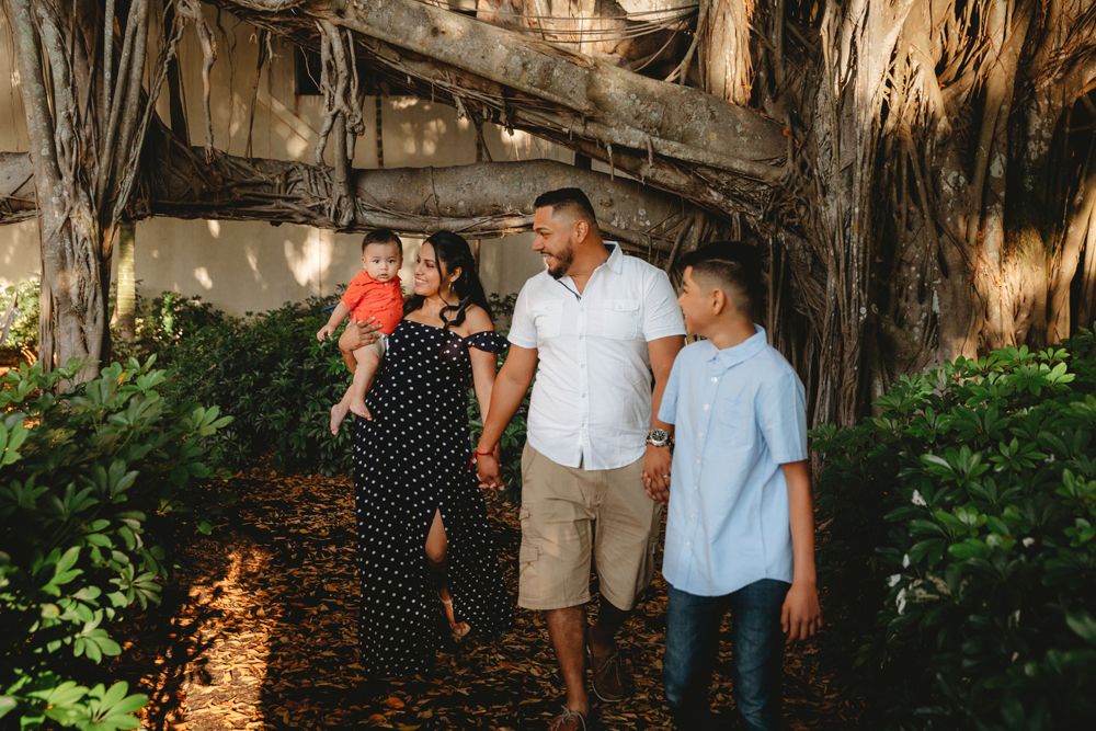 Naples Family Photographer, walking under a tree