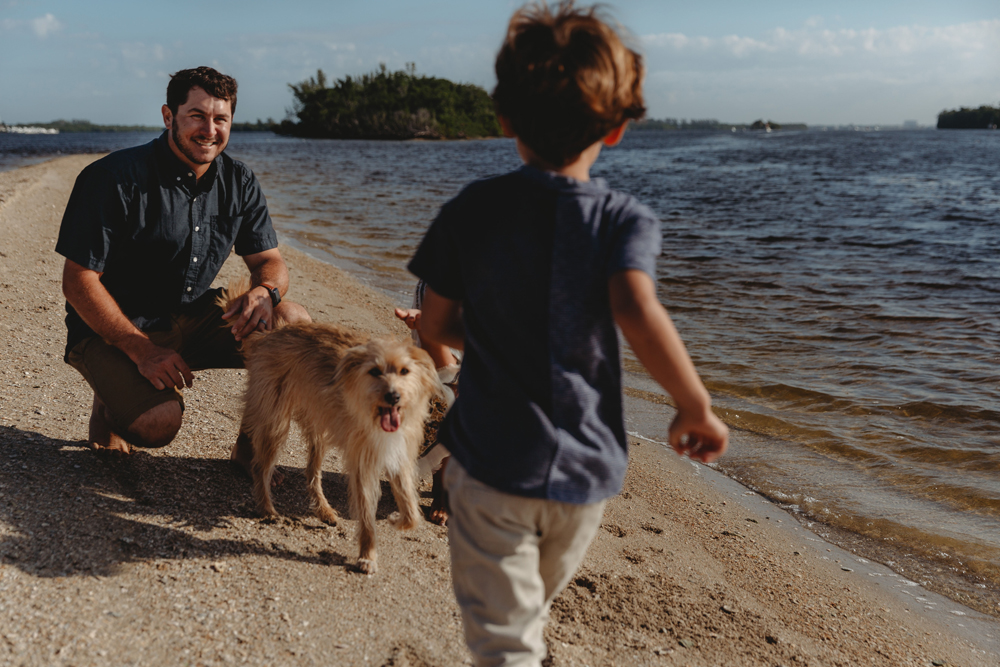 Naples Family Photographer, puppy looking at little boy
