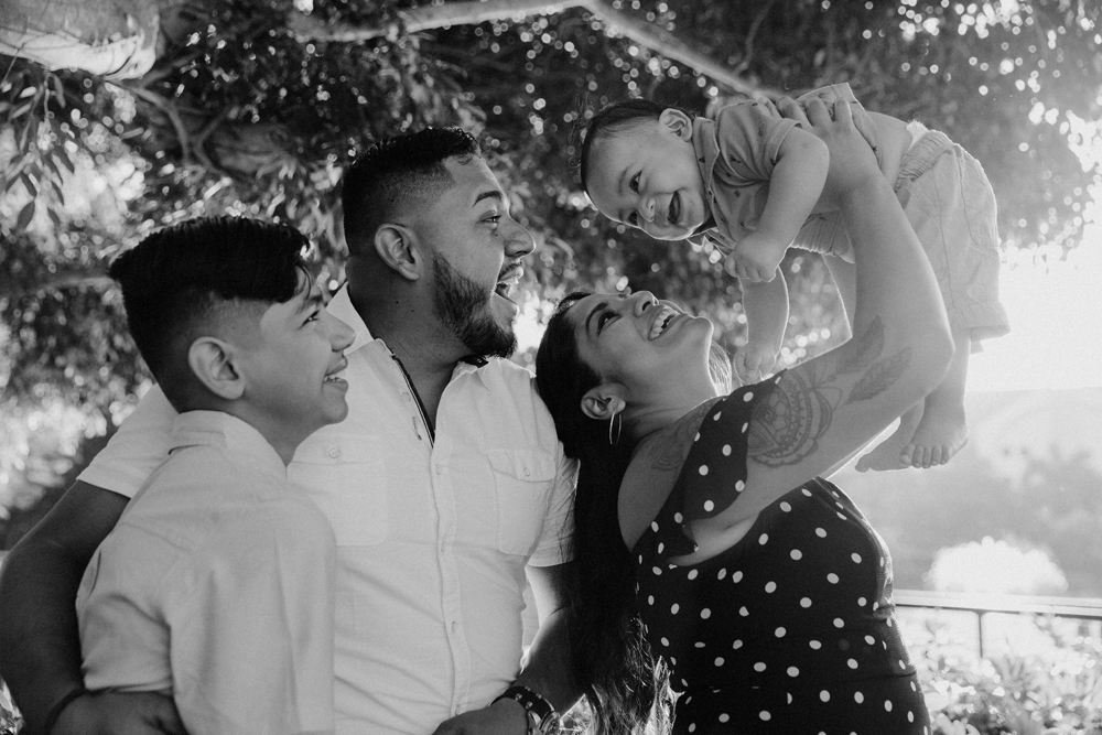 Naples Family Photographer, family smiling and laughing under a tree