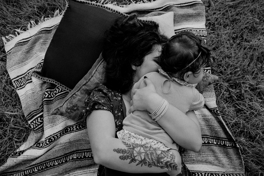 Naples Family Photographer, mother and baby laying on a blanket outside