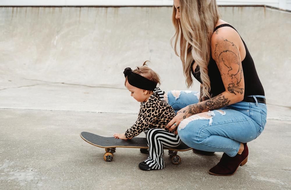 Naples Family Photographer, mother holding little baby on skateboard