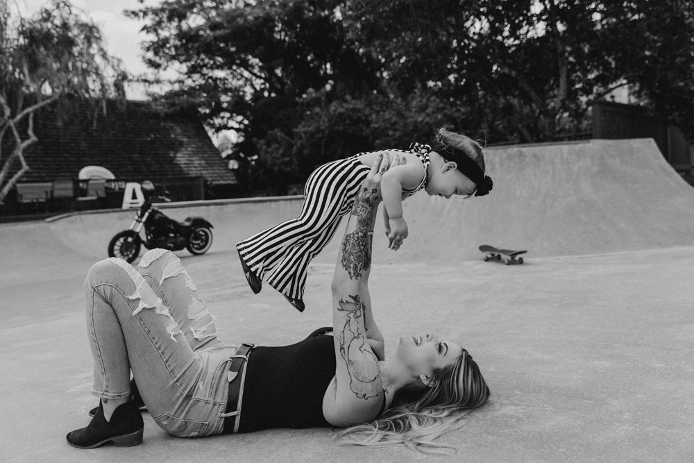 Naples Family Photographer, tattooed mom lifting up little girl