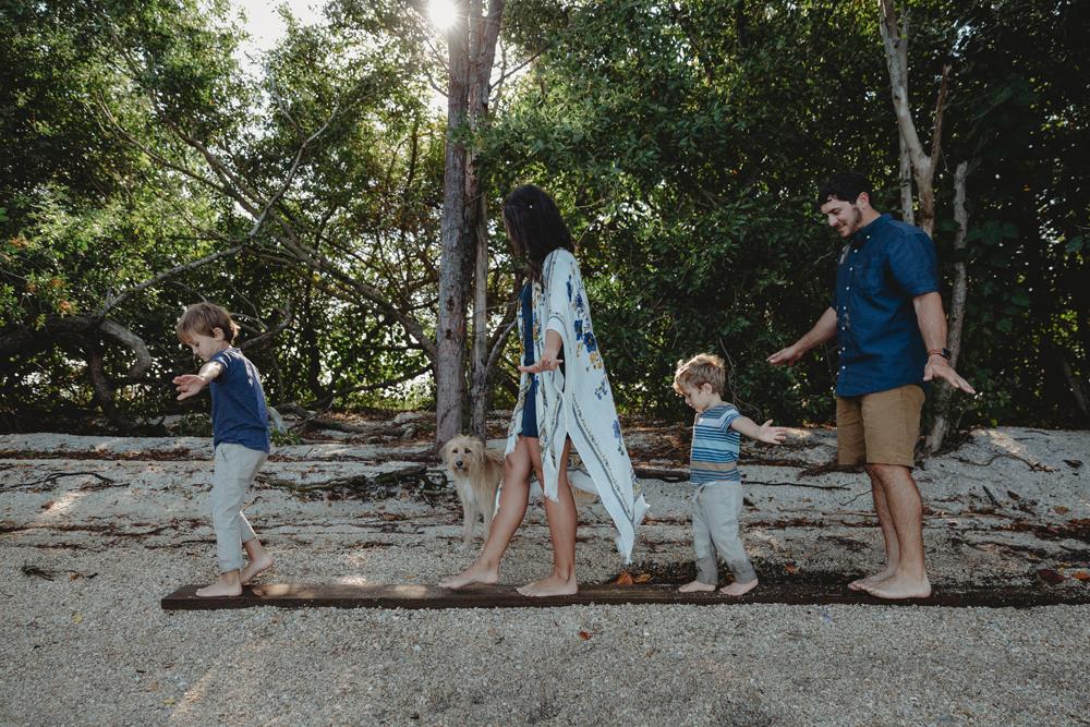 Naples Family Photographer, family walking on wooden beam