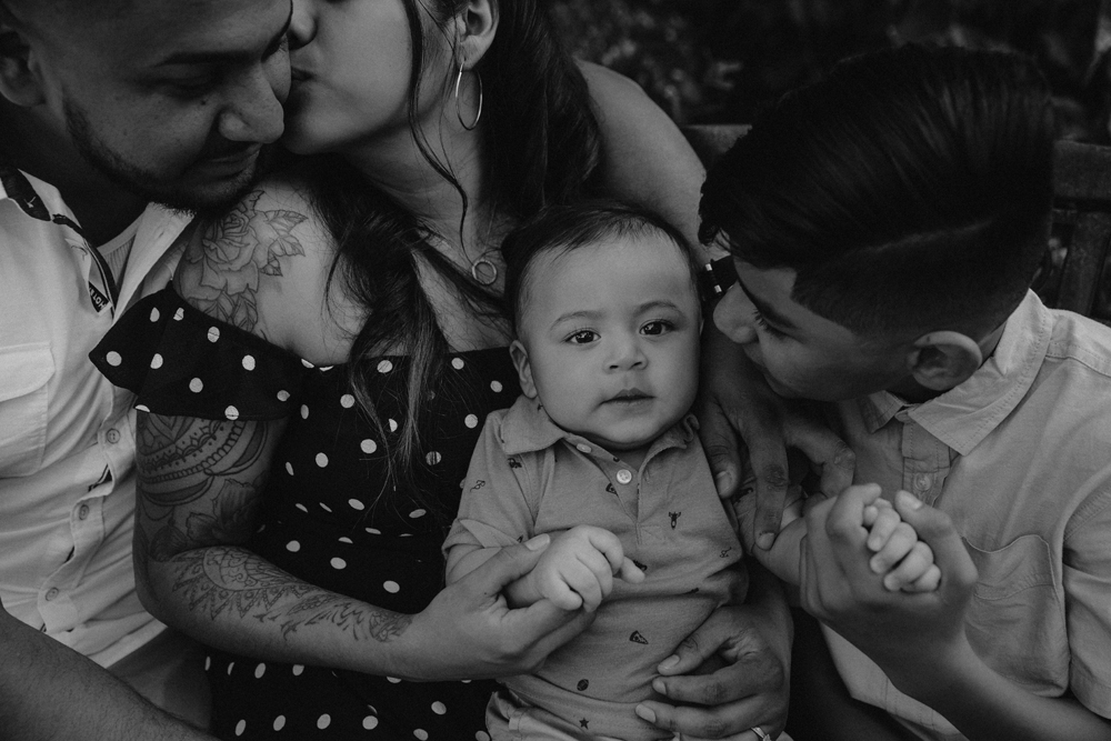 Naples Family Photographer, family sitting together