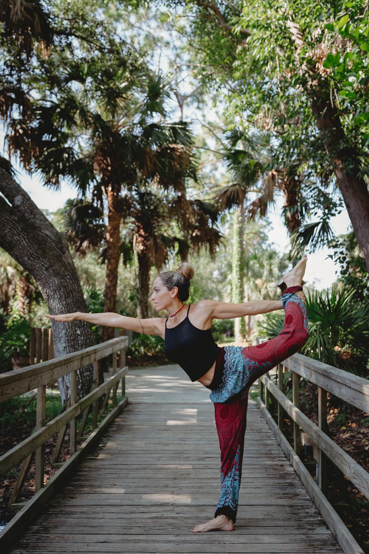 Naples Branding Photographer, woman doing yoga on a bridge