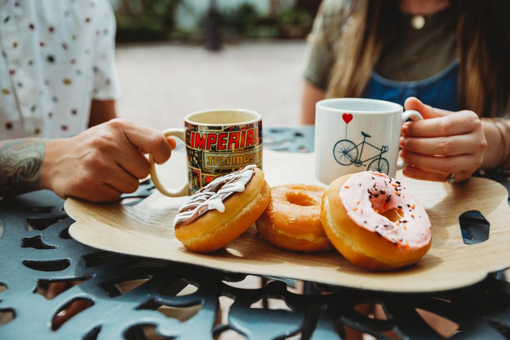 Naples Branding Photographer, couple having donuts and coffee