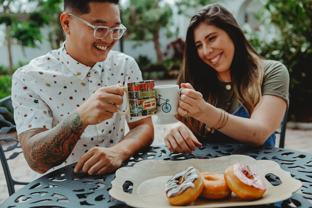 Naples Couples Photographer, couple having coffee and donuts