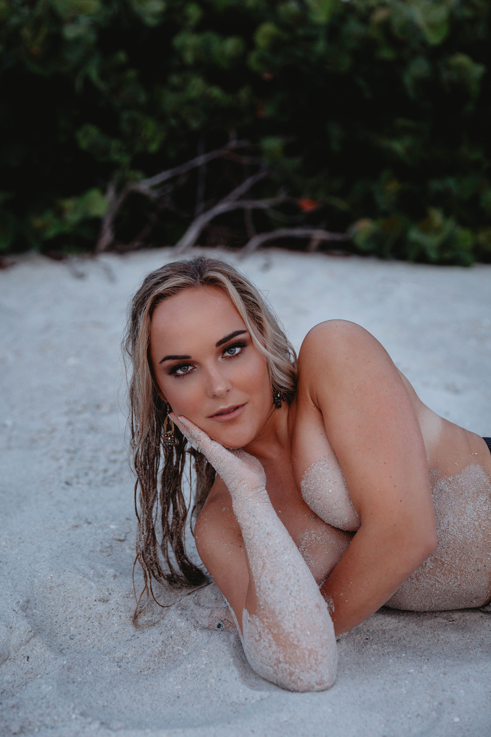 Naples Boudoir Photographer, blonde woman laying in the sand