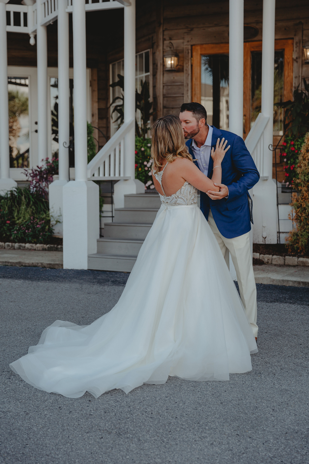 Naples Wedding Photographer, couple kissing outside of old house