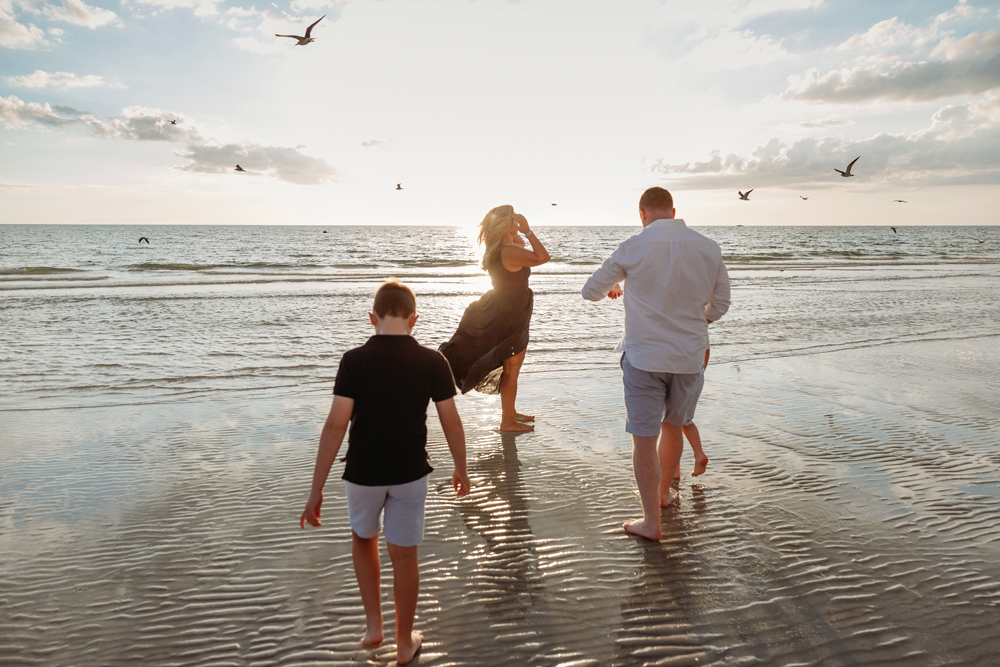 Naples Family Photographer, family of four standing in the shallows