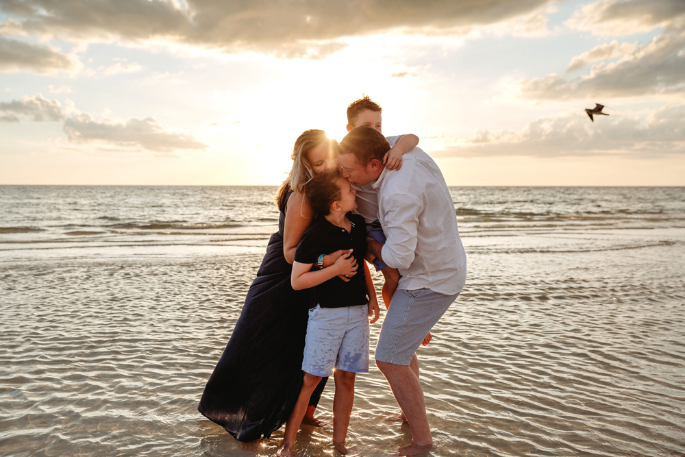Naples Family Photographer, family standing next to the ocean