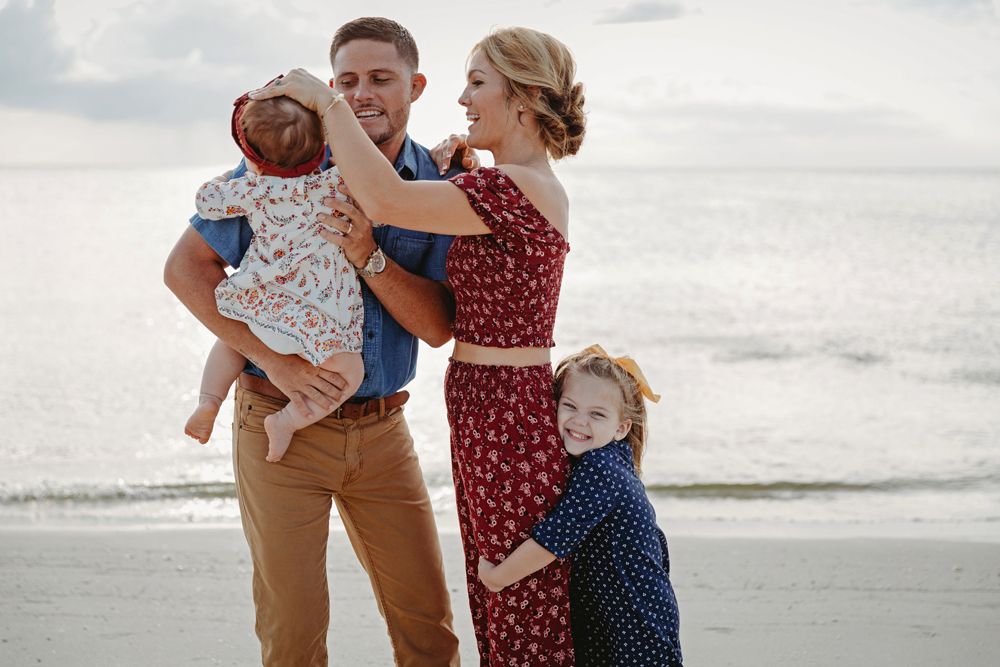 Naples Family Photographer, family of 4 playing on the beach
