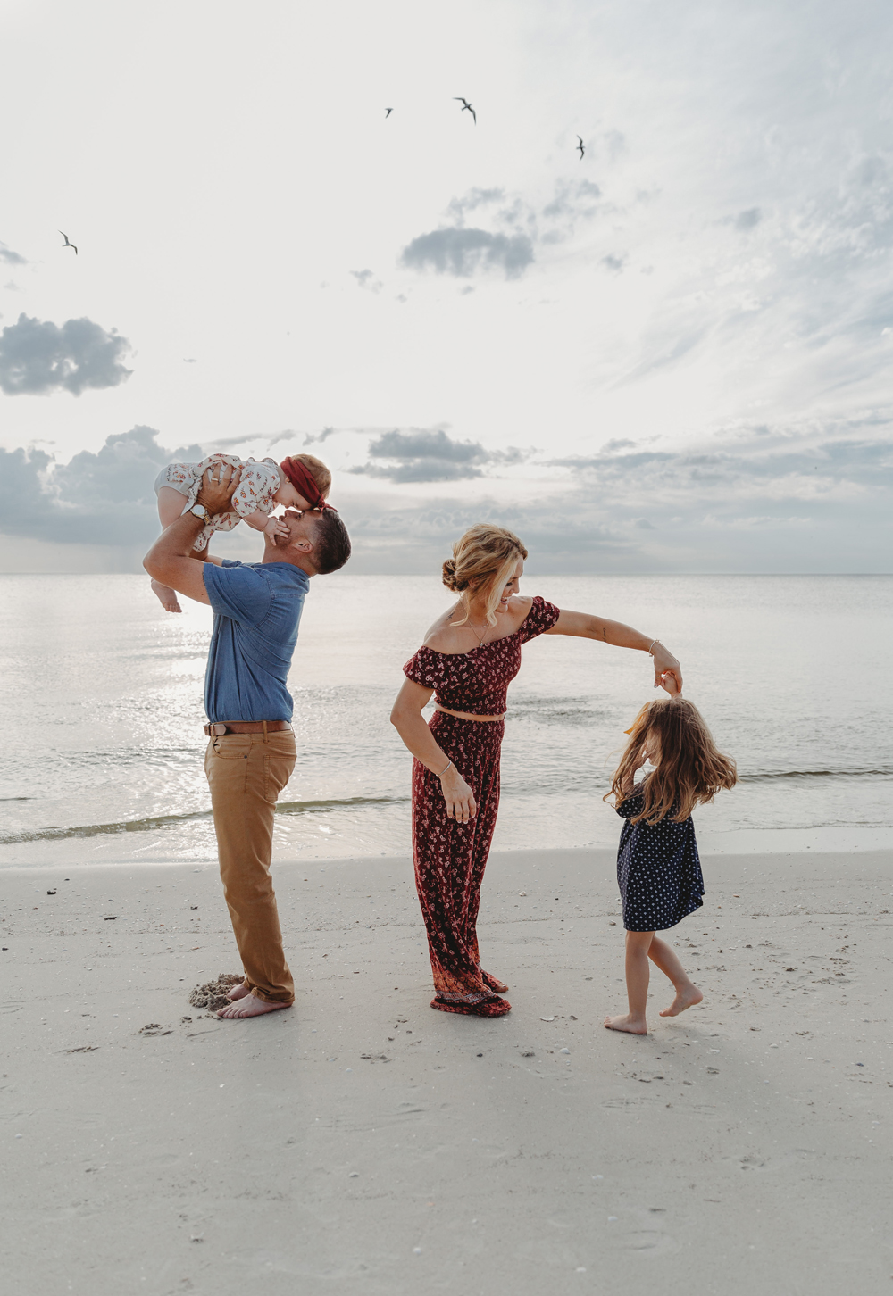 Naples Family Photographer, family playing together on the beach