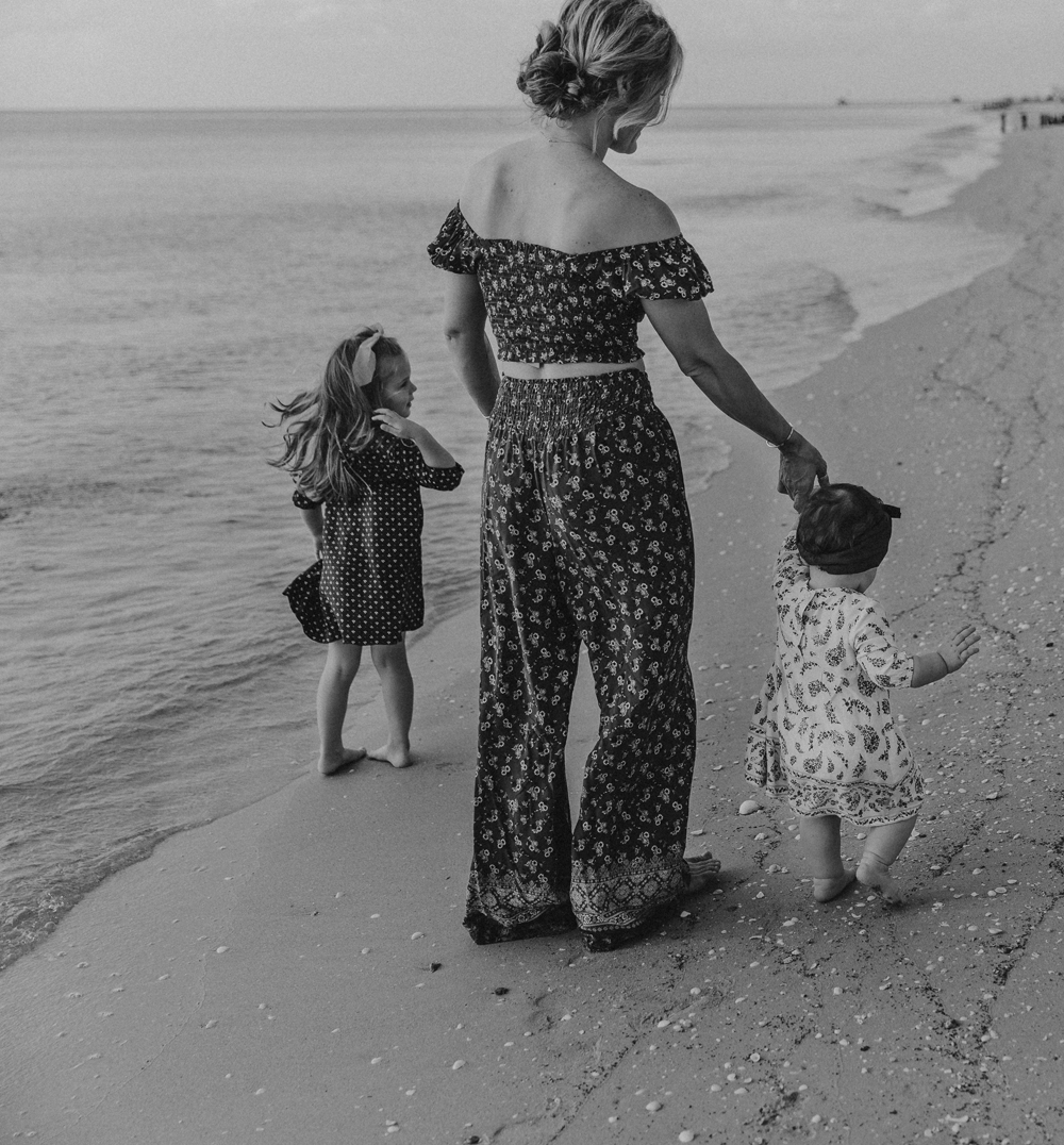 Naples Family Photographer, mom and daughters walk on beach