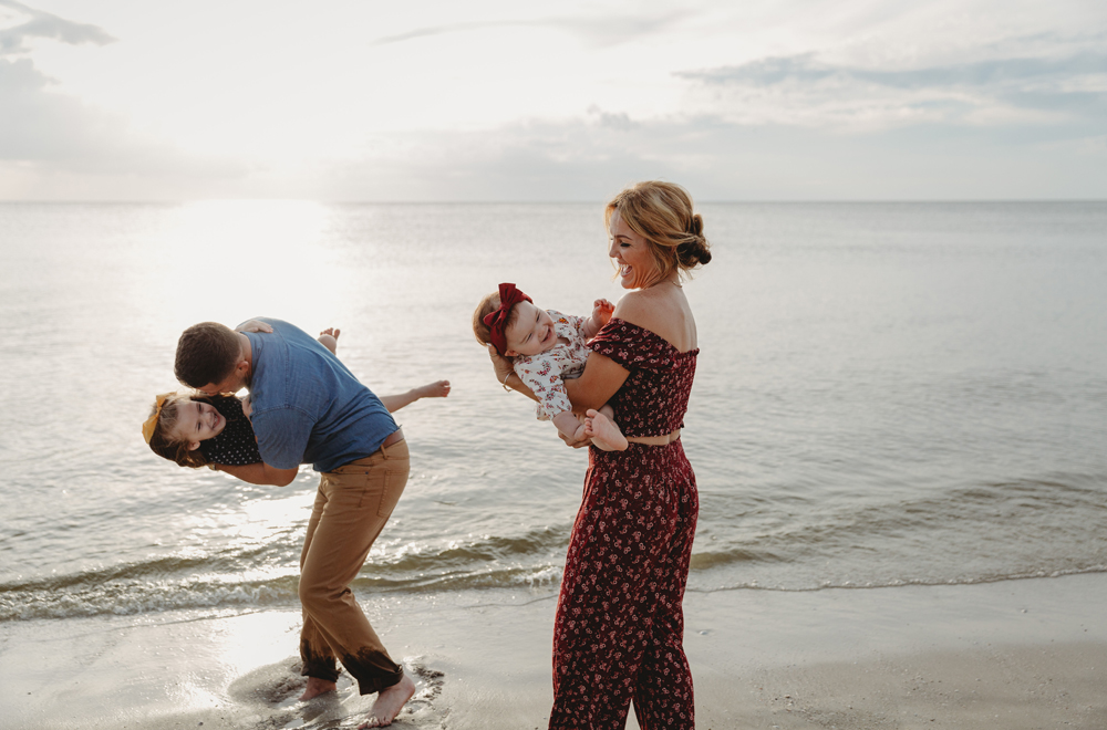 Naples Family Photographer, family playing at the beach