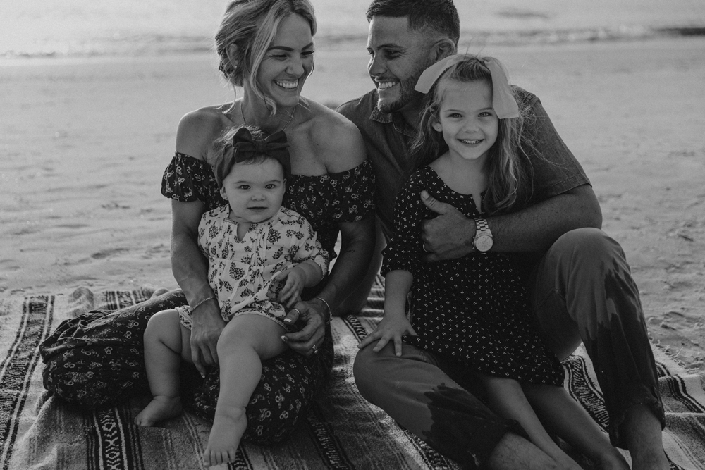 Naples Family Photographer, black and white image of family sitting at the beach