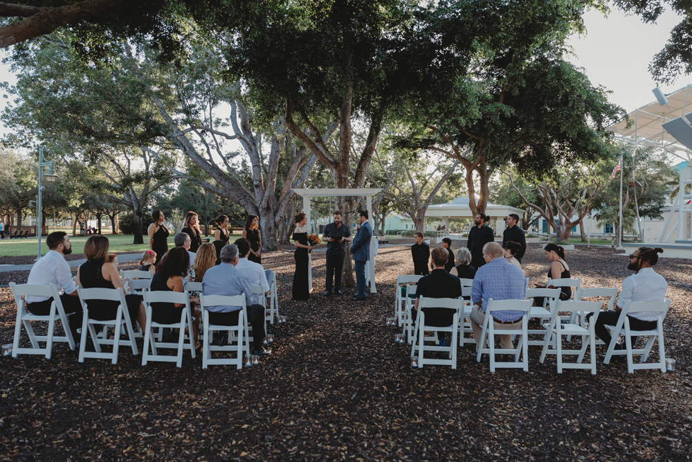Naples Wedding Photographer, wide angle of wedding ceremony under the trees