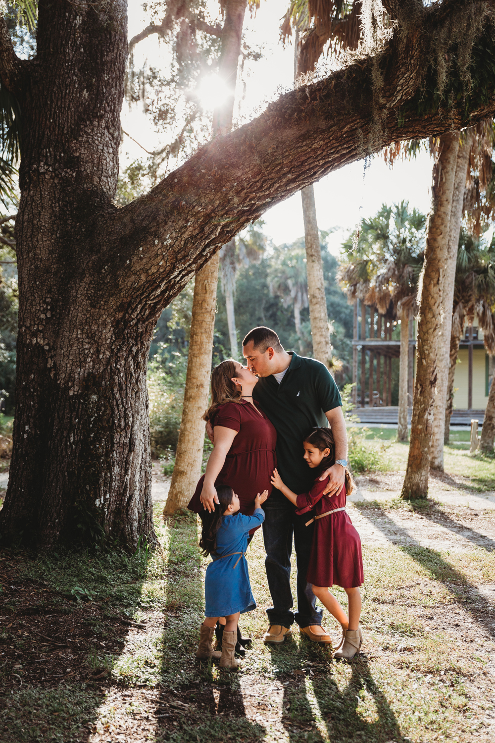 Naples Family Photographer, family kissing under a tree