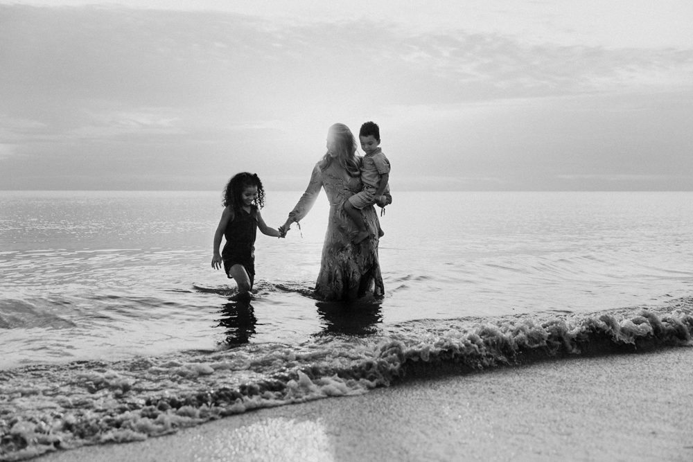 Naples Family Photographer, family in the ocean water