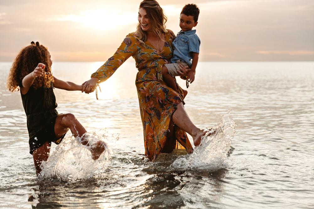 Naples Family Photographer, mother and kids splashing in ocean