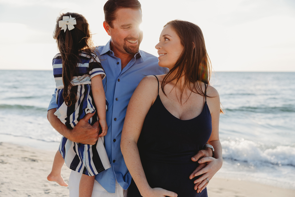 Naples Family Photographer, family with pregnant woman on the beach