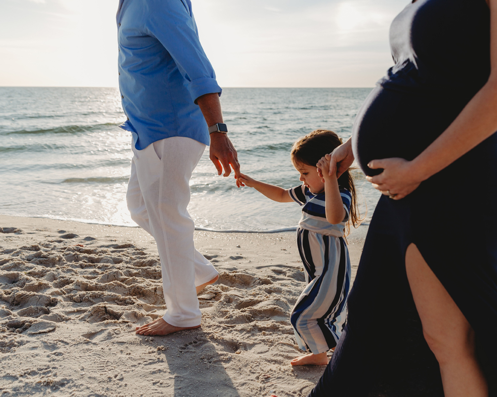 Naples Family Photographer, family walking along the beach holding hands
