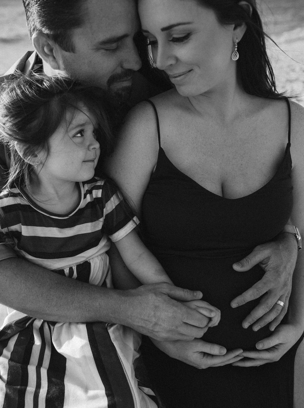 Naples Family Photographer, family cuddled together