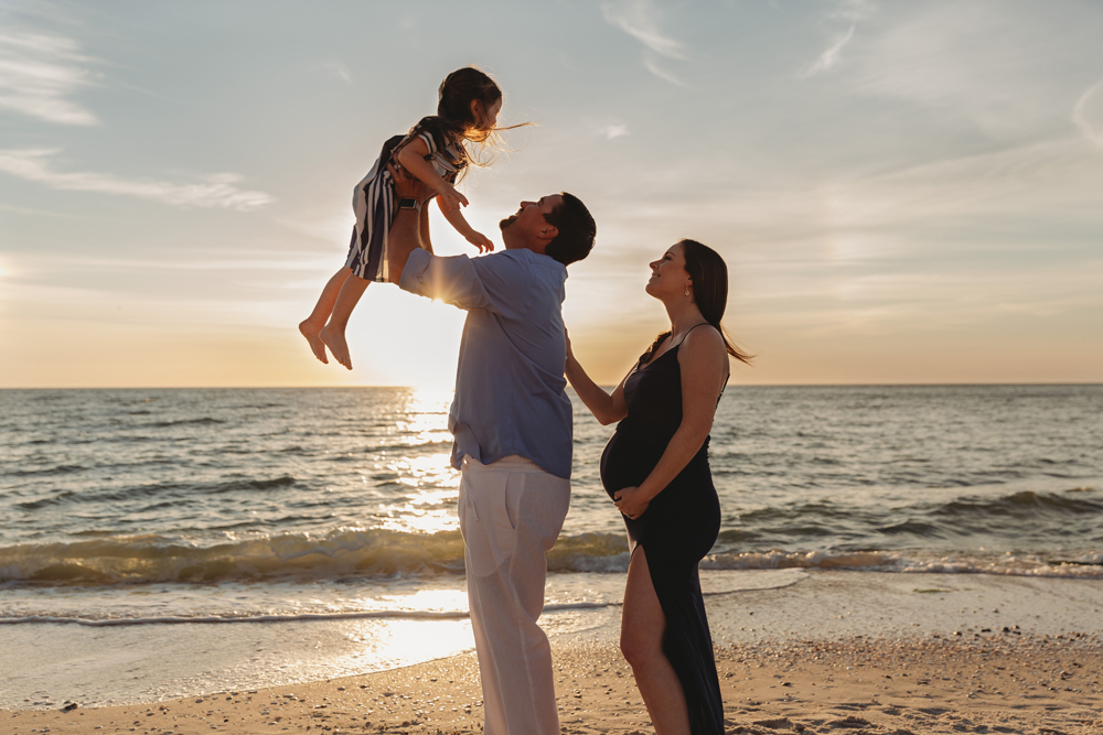 Naples Family Photographer, father lifting little girl into the air