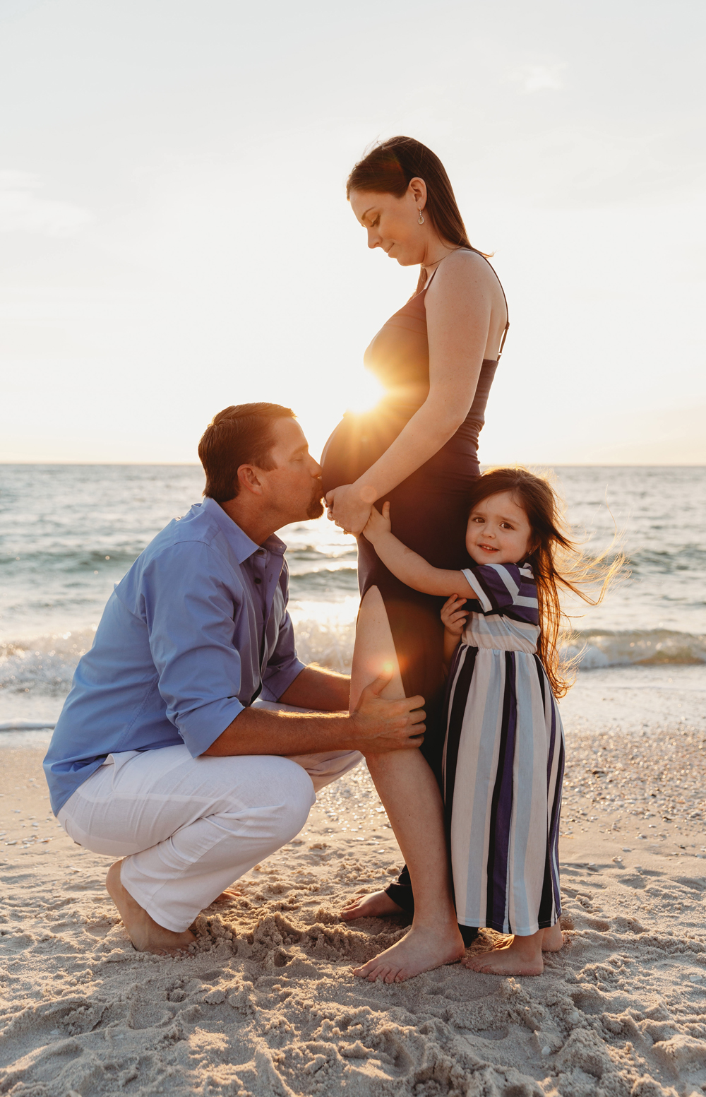 Naples Family Photographer, father kissing mama's belly