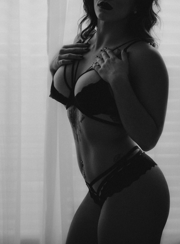Naples Boudoir Photographer, woman posing next to the window