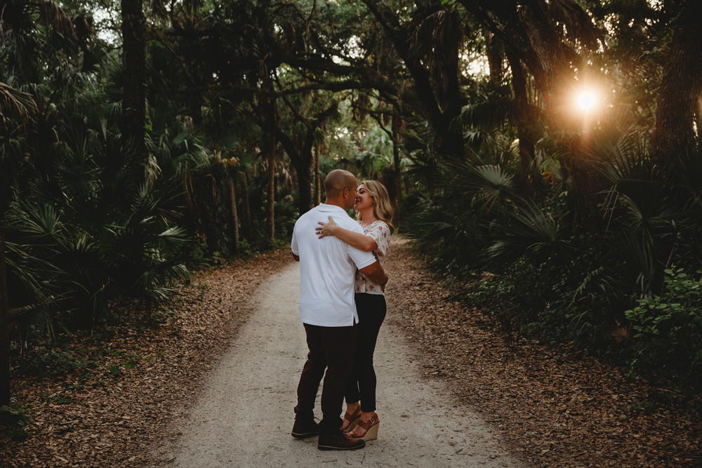 Naples Couples Photographer, couple slow dancing along a path at sunset