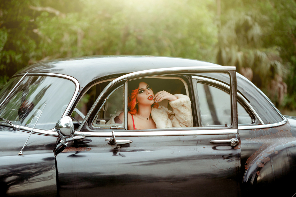 Naples Boudoir Photographer, posing in the drivers seat of old car