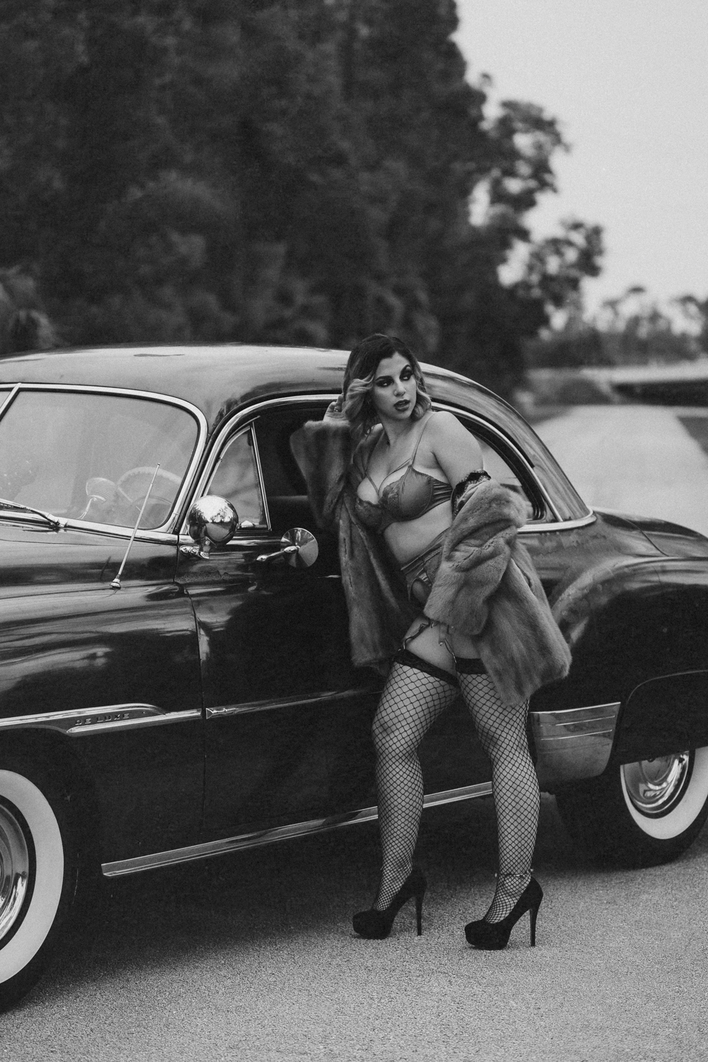 Naples Boudoir Photographer, black and white images of woman posing against a car