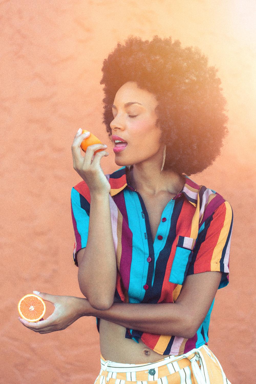 Naples Branding Photographer, taking a bite of orange