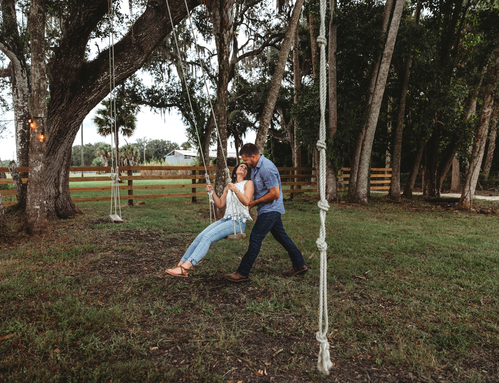 Naples Couples Photographer, couple playing on a tree swing